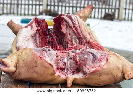 Cut pig carcass in the winter outdoor