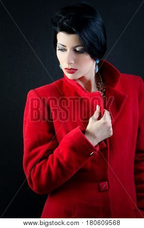 a girl is in a red overcoat