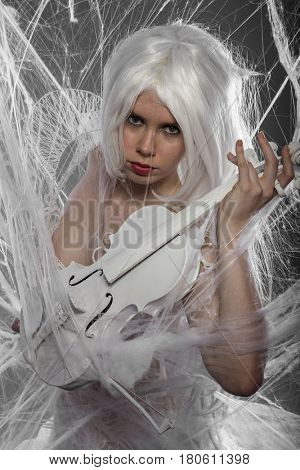 Violinist with white violin, beautiful girl with silver hair and lace clothes