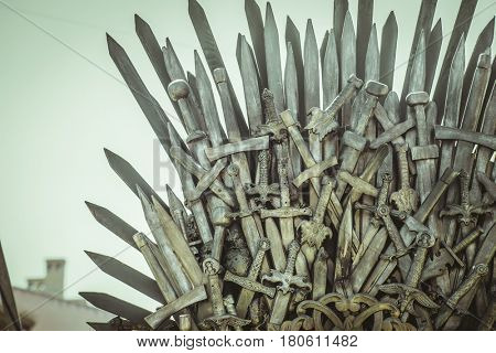 Iron throne made with swords, fantasy scene or stage. Recreation of a medieval seat