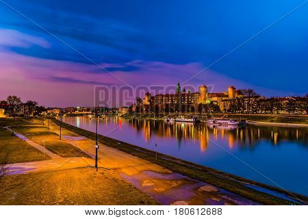 Royal castle of the Polish kings on the Wawel hill, over the Vistula river in the evening, Krakow, Poland poster