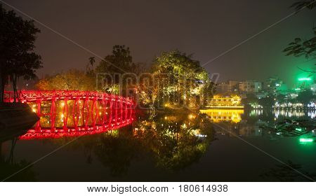 Hoan Kiem lake view at twilight with Ngoc Son old temple and The Huc bridge. Hoan Kiem lake (Sword lake or Ho Guom) is center of Hanoi