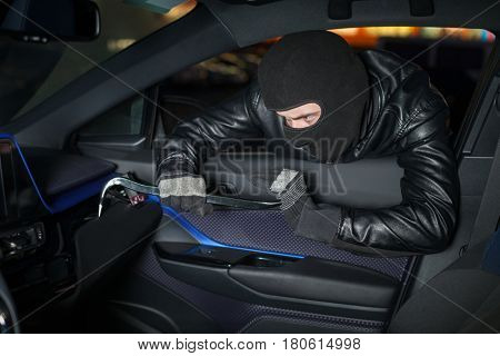 Carjacker unlock glove box with crowbar