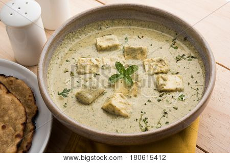 methi malai paneer or Creamy Fenugreek & Paneer Curry, popular north indian recipe prepared using milk cream, methi and paneer or cottage cheese, served with roti/paratha, selective focus