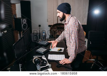 Sound engineer work with record in music studio