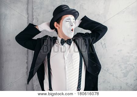 Pantomime artist with makeup mask, april fools day