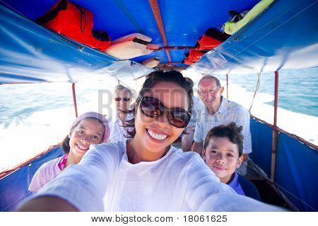 Happy family riding a fat boat going to an island.
