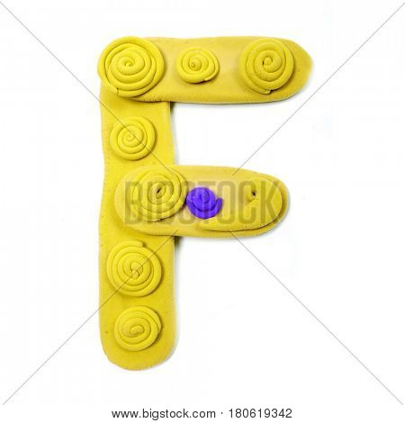 Plasticine letter F. Color plasticine alphabet, isolated.