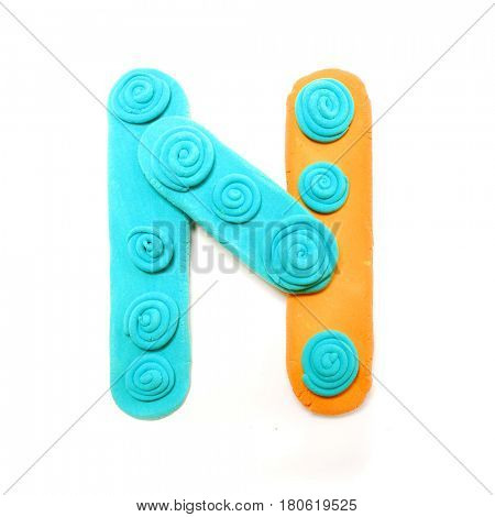 Plasticine letter N. Color plasticine alphabet, isolated.