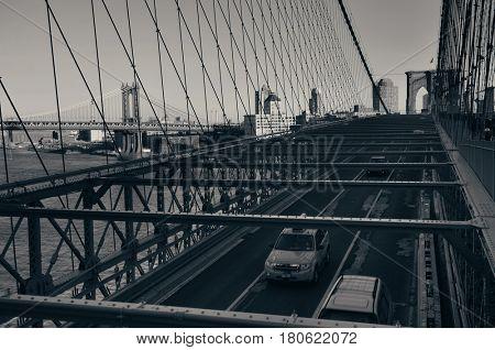 Brooklyn Bridge with traffic in downtown Manhattan New York City