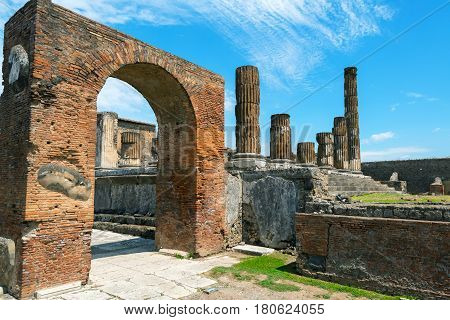 The ruins of Temple of Jupiter in Pompeii, Italy. Pompeii is an ancient Roman city died from the eruption of Mount Vesuvius in 79 AD.