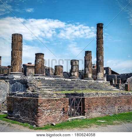 The ruins of the Temple of Jupiter Pompeii, Italy. Pompeii is an ancient Roman city died from the eruption of Mount Vesuvius in 79 AD.