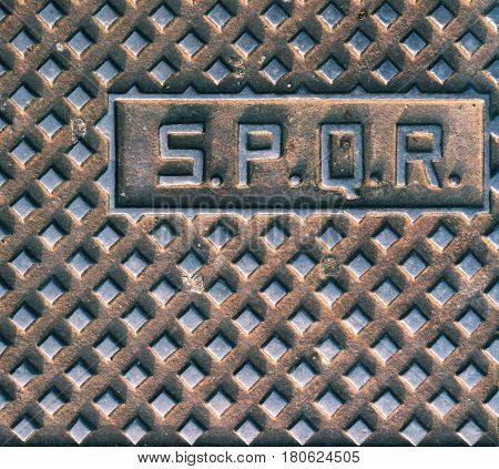 SPQR typical manhole cover in Rome, Italy