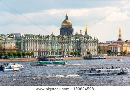 ST PETERSBURG, RUSSIA - JUNE 13, 2014: Tourist boats floating on the Neva River. St. Petersburg was the capital of Russia and attracts many tourists.