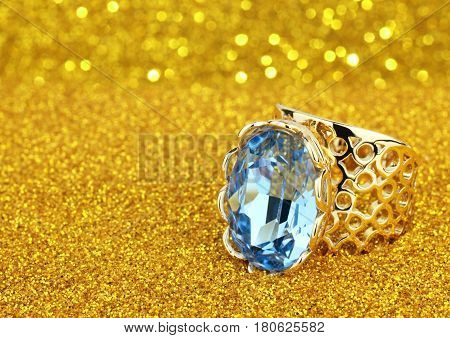 Jewelry ring with big diamond on golden background copy space