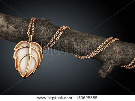 Golden Jewelery pendant as leaf on branch