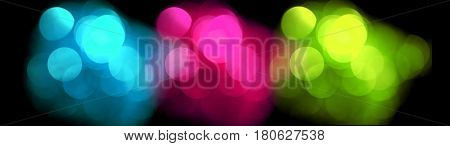 Colorful blurred lights, bokeh effect. Real photo background. Isolated on black