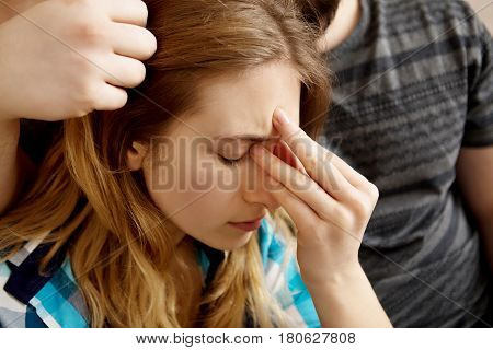 Woman is pressing her forehead, sinus pain.