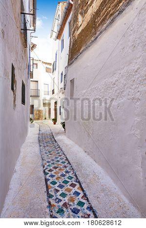 Chelva village street in Valencia of Spain Mediterranean whitewashed walls