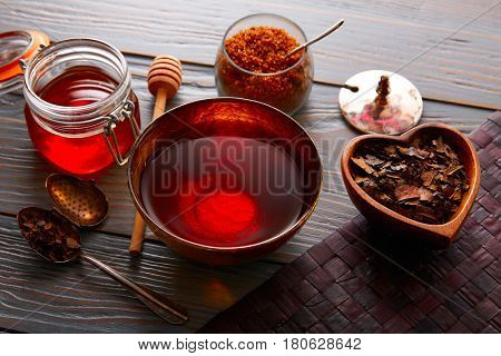 Bancha tea served in golden bowl on wooden table board