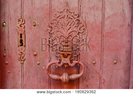 vintage keyhole in a old wood red door