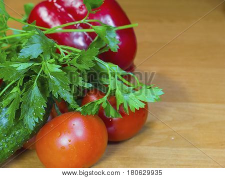 The fresh vegetables on the wood table