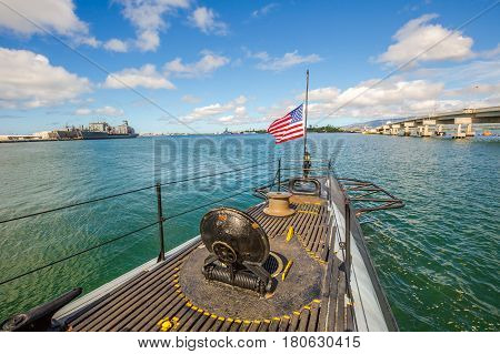 HONOLULU, OAHU, HAWAII, USA - AUGUST 21, 2016: American Flag on USS Bowfin Submarine SS-287. Pearl Harbor historic landmark, patriotic symbol and memorial of the Japanese attack in WW II.