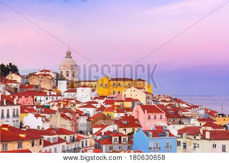View of Alfama, the oldest district of the Old Town, from belvedere Miradouro das Portas do Sol at scenic sunset, Lisbon, Portugal