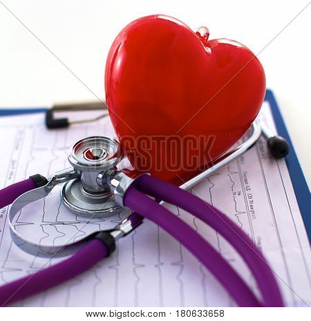 Medical stethoscope lies on the patient's medical history. Medical help or insurance concept.