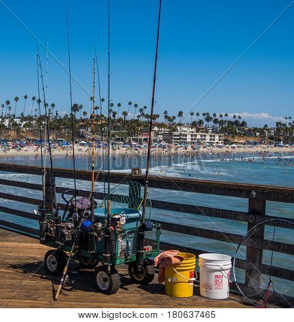 Fishing gear on the pier with beach and coastline in the distance