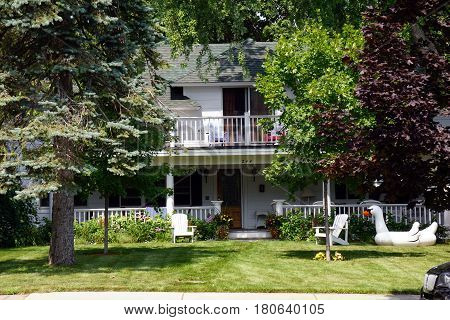 HARBOR SPRINGS, MICHIGAN / UNITED STATES - AUGUST 4, 2016: A two-story single family home with a balcony on West Third Street near downtown Harbor Springs.