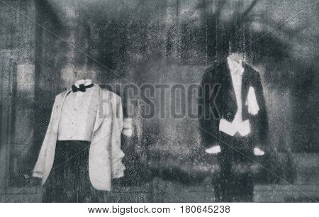 mannequins in the window behind dirty glass. The concept of the underside of a good living. Black and white and blurred background due to the concept. empty space for your text