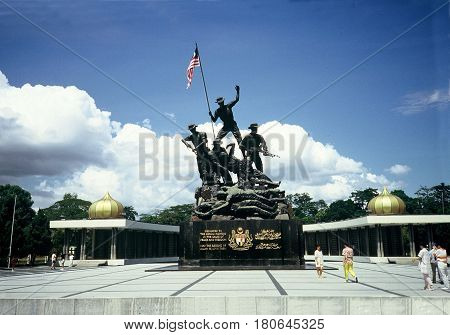 KUALA LUMPUR / MALAYSIA - CIRCA 1987: The National Monument is a sculpture that commemorates those who died in Malaysia's struggle for freedom, principally against the Japanese occupation during World War II and the Malayan Emergency, which lasted from 19