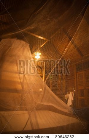 Mosquito Net Over Bed In The Guesthouse Of  Khao Sok Sanctuary, Thailand