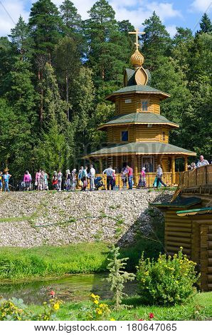TSYGANOVKA RUSSIA - AUGUST 22 2015: Unknown people visit chapel on holy spring in name of Monk Seraphim of Sarov near village of Tsyganovka of Nizhny Novgorod region Russia