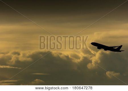 Silhouette airplane in the sky, transportation concept picture.