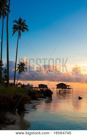 Beautiful early morning sunrise over a tropical island