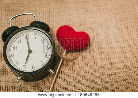 Love clock at 7 o'clock Time of sweet loving pass memories story on old style background.