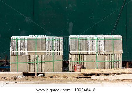 pallets of concrete blocks for the pavement