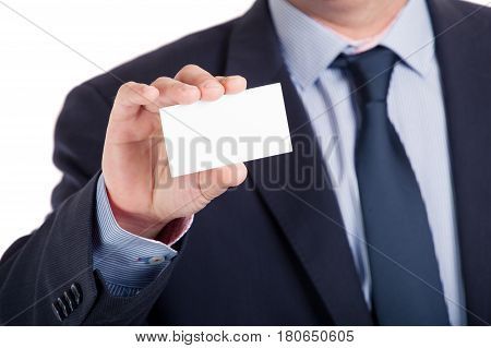 Businessman shows business card shallow dept of field isolated