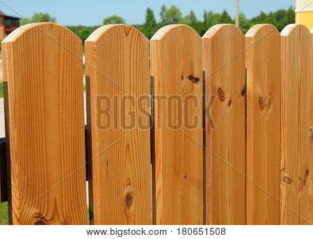 Closeup on wooden gate ( wicket ) and wooden fence detail construction with doorway outdoor. wooden fencing. Textured Background