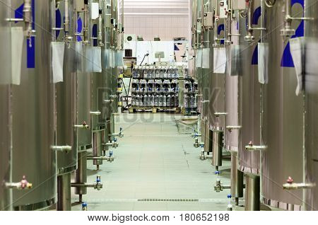 Modern Beer Factory. Rows of steel tanks for beer fermentation and maturation.