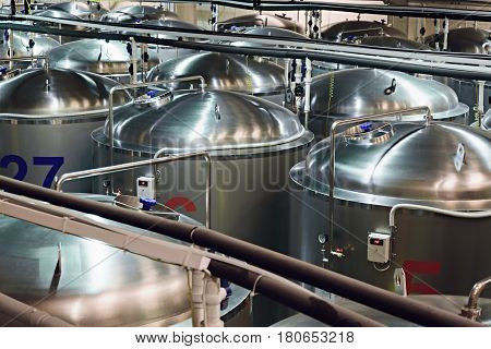 Tanks of stainless steel for the fermentation of beer. beer making shop.