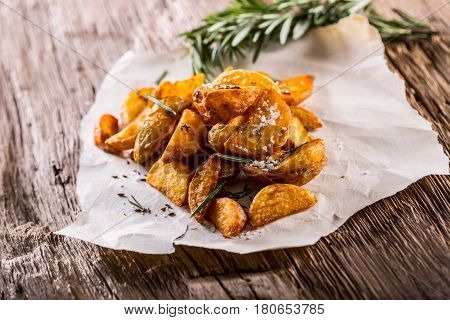 Potato. Roasted potatoes. American potatoes with salt rosemary and cumin. Roasted potato wedges delicious crispy.