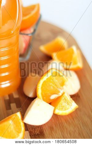 Bottle Of Orange Juice And Sliced Apple And Orange