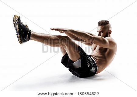 Handsome young man doing fitness exercise. Photo of muscular man in silhouette on white background. Fitness and healthy lifestyle concept