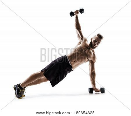 Strong man doing fitness plank position exercises with dumbbells. Photo of man in silhouette on white background. Fitness and healthy lifestyle concept