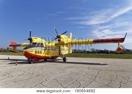 PULA, CROATIA - MARCH 25, 2017: Bombardier CL-415 water bomber aircraft on exhibition in Pula airport during 50. years of anniversary of first commercial flight in Pula
