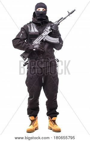 Terrorist Holding A Machine Gun In His Hands Isolated Over White