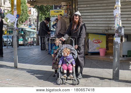Undefined Orthodox Jewish Man With Kids Walk In Jewish Quarter. Jerusalem. Israel